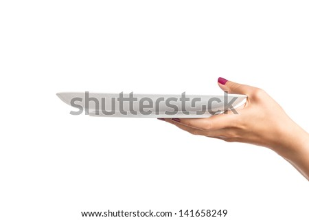 Blank plate in female hand - stock photo