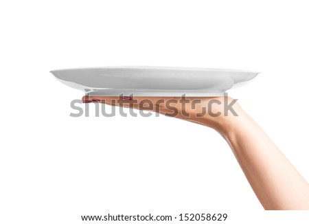 Blank plate on hand - stock photo