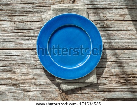 Blank plate on wooden table background  - stock photo