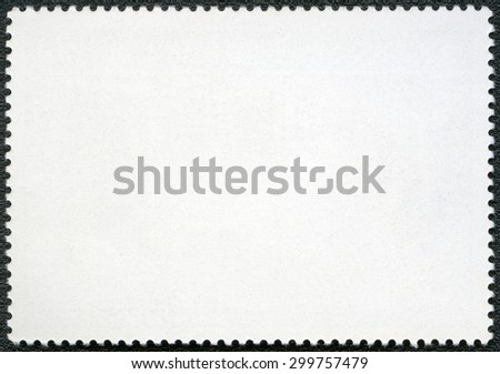 Blank postage stamp on a black background - stock photo