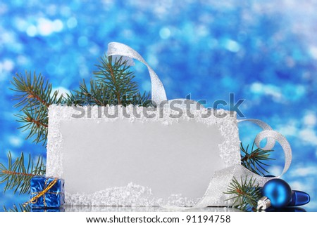 blank postcard, Christmas balls and fir-tree on blue background
