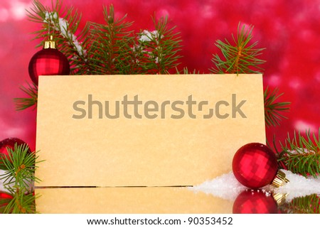 blank postcard, Christmas balls and fir-tree on red background - stock photo