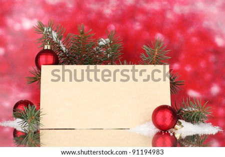 blank postcard, Christmas balls and fir-tree on red background