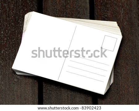 blank postcards on wooden table - stock photo