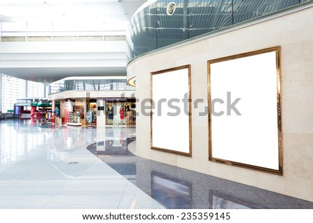 blank poster board wall in modern shopping mall - stock photo