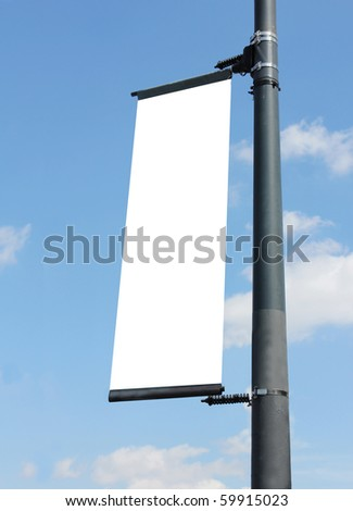 blank poster on lamppost with blue sky - stock photo