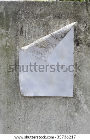 blank poster  on the weathered wall on the street - stock photo