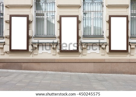Blank posters on the wall. Isolated with clipping path - stock photo
