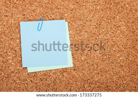 Blank postit note on cork wood notice board with copy space - stock photo