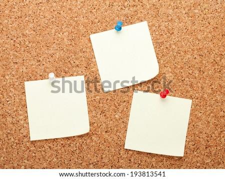 Blank postit notes on cork wood notice board - stock photo