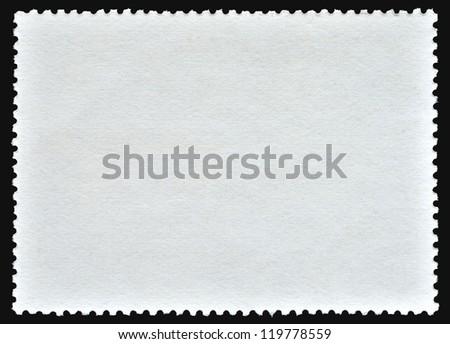 Blank poststamp on black background - stock photo