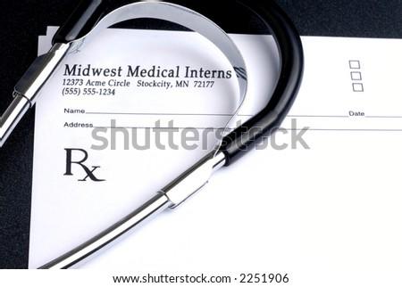 Blank Prescription Pad and Stethoscope - stock photo