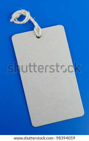 Blank product info label on blue background. - stock photo