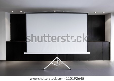 Blank projector canvas in the office - stock photo