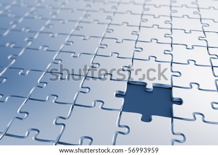 Blank puzzle with a missing piece - shallow depth of field - stock photo