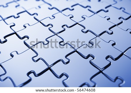 Blank puzzle with blue tint and shallow depth of field - stock photo