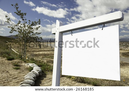 Blank Real Estate Sign and Empty Construction Lots - Ready for your own message. - stock photo