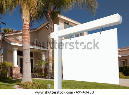 Blank Real Estate Sign and New Home Ready for Your Own Text. - stock photo