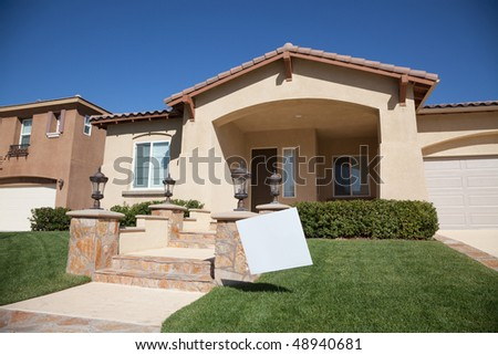 Blank Real Estate Sign in Front of Beautiful New Home. - stock photo