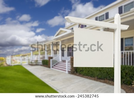 Blank Real Estate Sign in Front of Beautiful New House. - stock photo