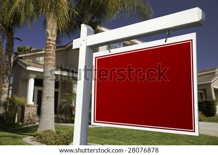 Blank Real Estate Sign in Front of House. - stock photo