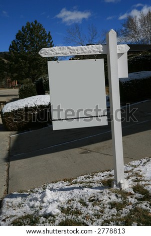 Blank real estate sign in the snow - stock photo