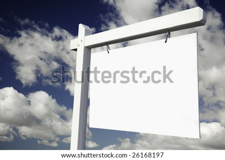 Blank Real Estate Sign on Clouds & Sky Background - Ready for your own message. - stock photo