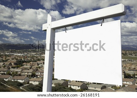 Blank Real Estate Sign with Elevated Housing Community View - Ready for your own message. - stock photo