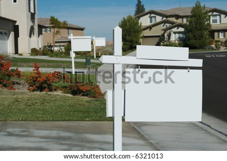 Blank Real Estate Signs in a Row - Ready for your own message. - stock photo
