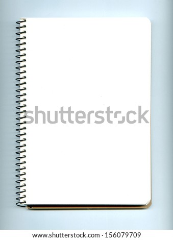 Blank realistic spiral notepad notebook on white background. Red brick wall texture. - stock photo
