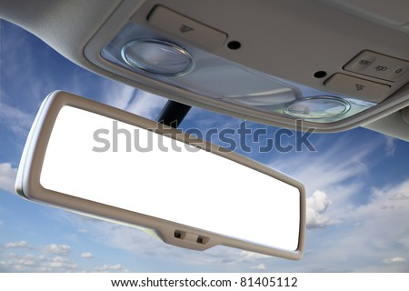 Blank rear view mirror against blue sky. - stock photo