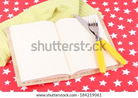 Blank recipe book on bright background - stock photo