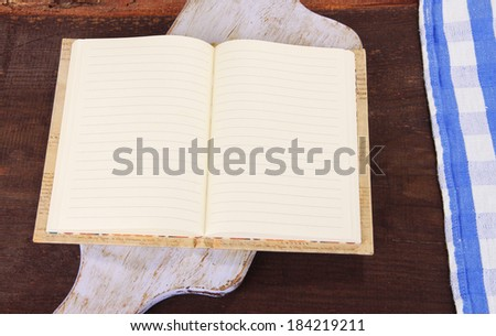 Blank recipe book on wooden background - stock photo