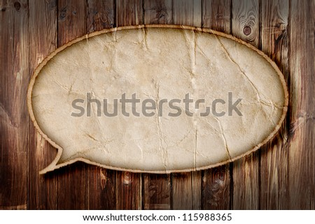 Blank Recycle paper Speech Bubble on wood background - stock photo