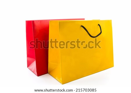 Blank red and yellow paper shopping bag on white background. - stock photo