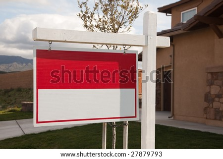 Blank Red Real Estate Sign in Front of House Ready for Your Own Copy. - stock photo