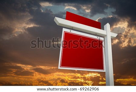 Blank Red Real Estate Sign Over Sunset Sky Ready For Your Own Message. - stock photo