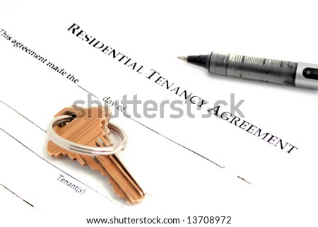 blank residential tenancy agreement with pen,and keys - stock photo