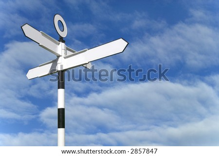 Blank road sign against a blue sky background - stock photo