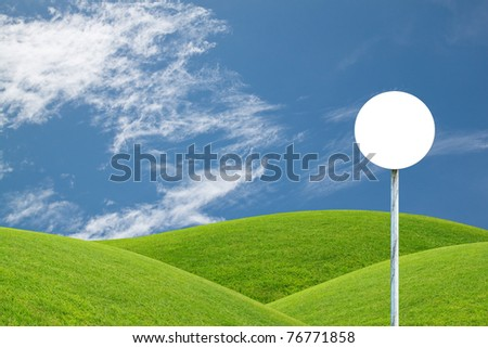 Blank Road Sign and green hill - stock photo