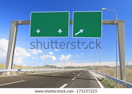 Blank road sign on highway. Add your own text - stock photo