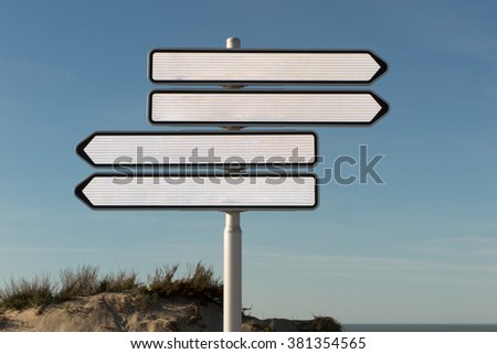 Blank road sign on the street - Add your own text - stock photo