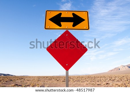 Blank road sign with arrows