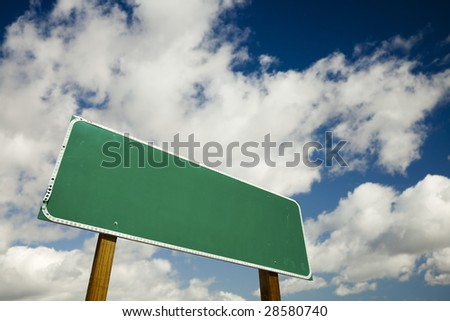 Blank Road Sign with dramatic clouds and sky ready for your own copy. - stock photo