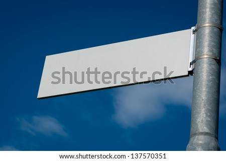 Blank Road Sign with sky and clouds. - stock photo