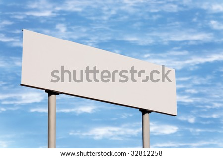 Blank road sign without frame against sky