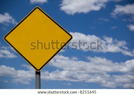 blank roadsign ready for text against a blue sky background - stock photo