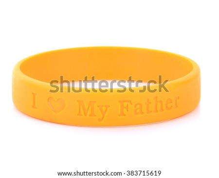 Blank rubber plastic stretch yellow bracelet isolated on white background. - stock photo