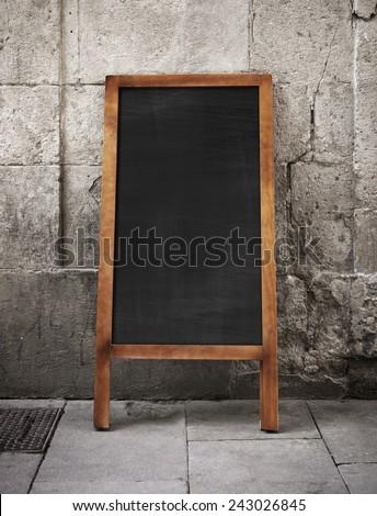 Blank sandwich board on a street - stock photo