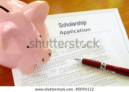 Blank scholarship application form with piggy bank - stock photo